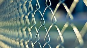 a closeup shot of metal fence