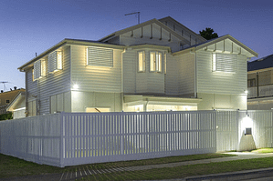 a newly-built home with a fence